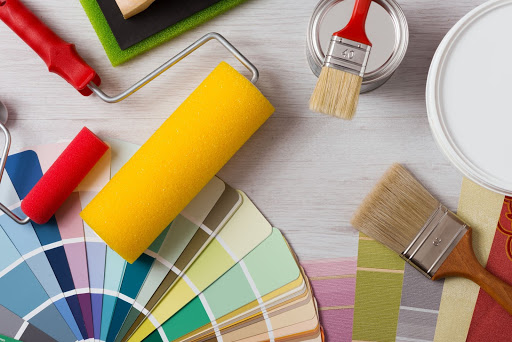 Paint brushes, rollers and colour charts